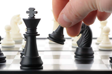 Pawn in hands over a chessboard. Selective focus Stock Photo - 12240631