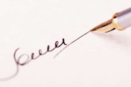 fountain pen writing: The signature close up and fountain pen. Selective focus