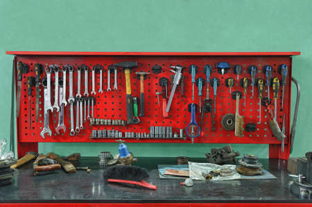 garage background: Set of the working tool at the stand. A workplace of the mechanic Stock Photo