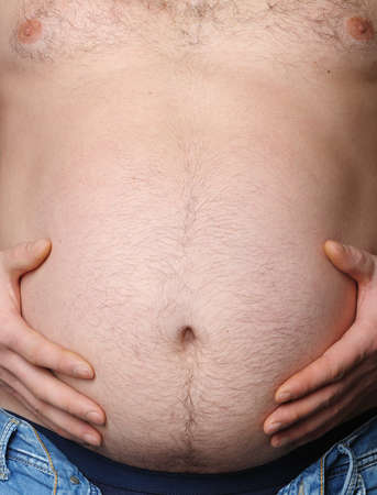 Man's stomach close up. Concept - overweight Stock Photo - 12240776
