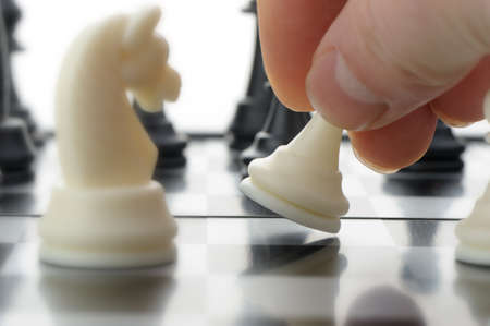 business decisions: Pawn in hands over a chessboard. Selective focus Stock Photo