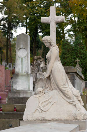 Tombstone women with a cross. Since its creation in 1787 Lychakiv Cemetery Lvov, Ukraine. photo