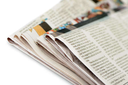 broadsheet: Stack of newspapers. A photo close up. Selective focus Stock Photo