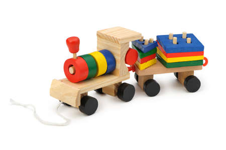 Childrens wooden steam locomotive a toy. It is isolated on a white background photo