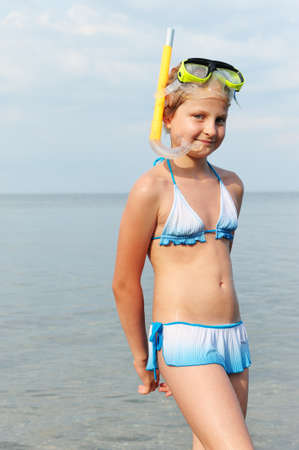 bikini island: The girl on seacoast. In a mask, and with a snorkel