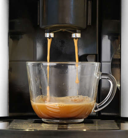 espresso machine: coffee machine. Process of preparation of an espresso. Photo on long exposure. Stock Photo