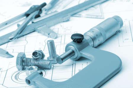 The plan industrial details, a screws, caliper, divider,micrometer. A photo closeup. Blue toning photo