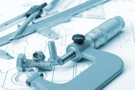 The plan industrial details, a screws, caliper, divider,micrometer. A photo closeup. Blue toning photo