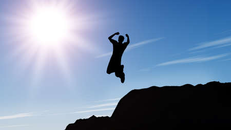 cliff jumping: Silhouette of the jumping man from a rock. A shining sun with beams