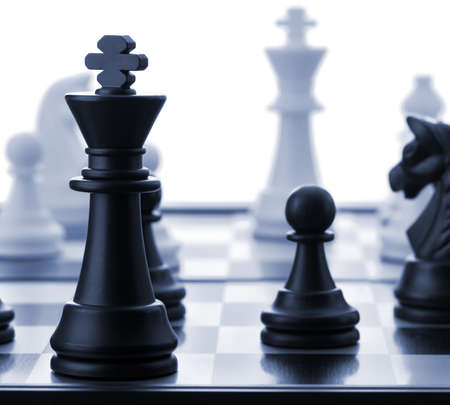 The black chess king.Blue toned. Selective focus Stock Photo - 12700994