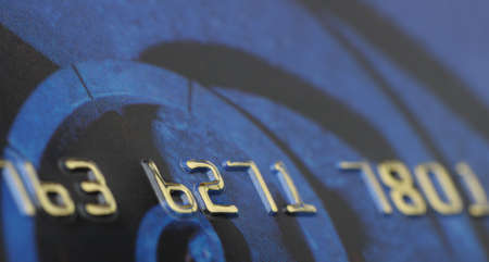 Credit card closeup. Selective focus on gold numbers photo