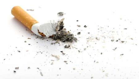 ashes: cigarette butt. Photo closeup. On white