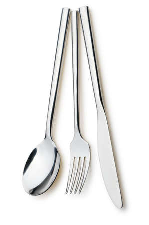 Spoon, fork and a knife. It is isolated on a white background photo