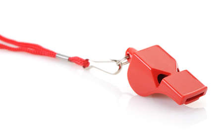 whistles: Sports whistle with a lace. It is isolated on a white background Stock Photo