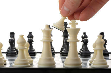 Pawn in hands over a chessboard. Selective focus Stock Photo - 12701000