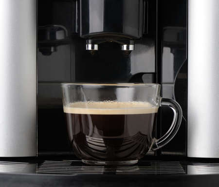 expresso: coffee machine. Process of preparation of an espresso. Photo on long exposure. Stock Photo