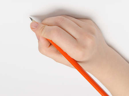 Hand with pencil. Over grey empty a paper. Imitation to write Stock Photo - 12701088