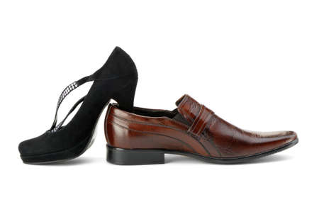 Female and mans shoes. It is isolated on a white background photo