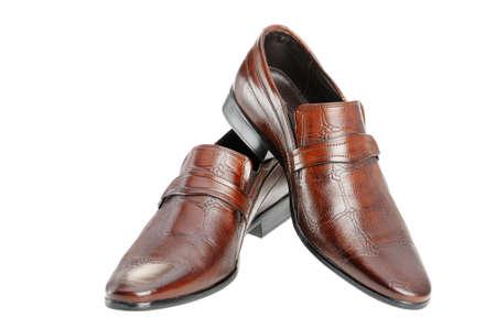 calzado de seguridad: Par de zapatos de hombre. Un piel roja. Es aislados sobre un fondo blanco Foto de archivo