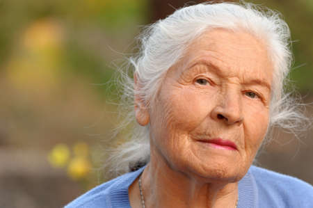 one senior woman only: Portrait of the elderly woman. A photo on outdoors