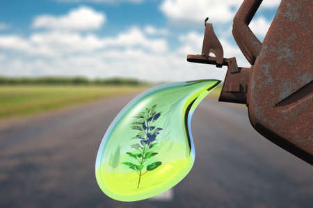 Biofuel.The canister with a drop of gasoline and a plant in it. Concept of non-polluting fuel Stock Photo - 12701329