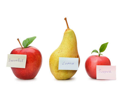 Pear and red apples with paper notes. Inscriptions on the notes Breakfast, lunch and dinner. The concept of diet photo