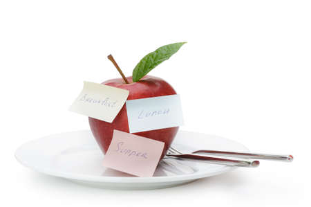 Apple with paper notes. Inscriptions on the notes Breakfast, lunch and dinner. The concept of diet Stock Photo - 12920736