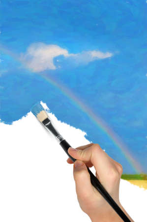 The hand with a brush draws a landscape.The blue sky, field and rainbow Stock Photo - 12920762