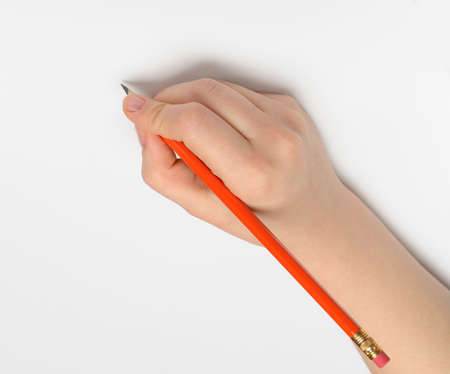 Hand with pencil. Over grey empty a paper. Imitation to write Stock Photo - 13483128