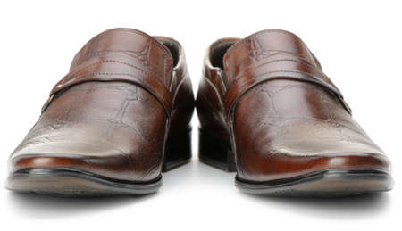front view: Pair of mans shoes. A red skin. It is isolated on a white background