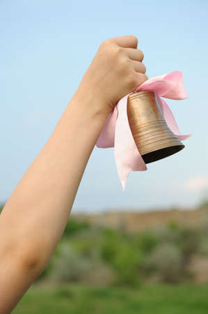 the end of the year: The hand with a bell. End of the academic year Stock Photo