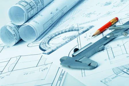 caliper: The plan industrial details, a ruler, caliper, divider and a red pencil. A photo closeup. Blue toning
