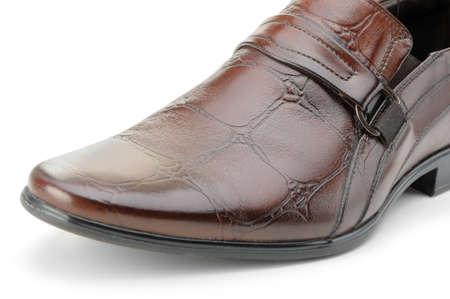 Man's shoes. A red skin. A photo closeup.