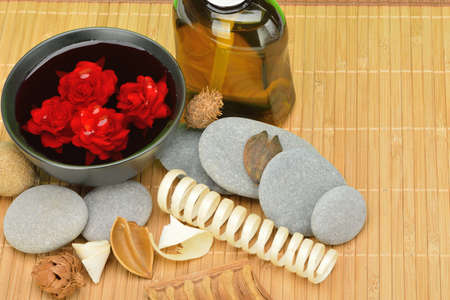 Object for the spa. Pebble, Lily, liquid soap, bowl with roses in water. Stock Photo - 13760274