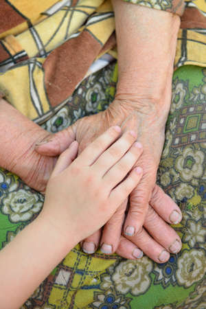 in loving memory: Old and young hands