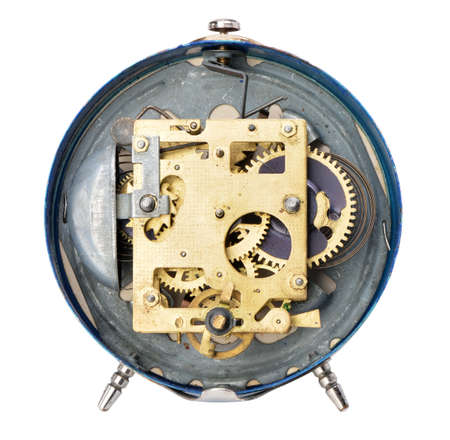 Rear side of the old alarm clock. Isolated on white background photo