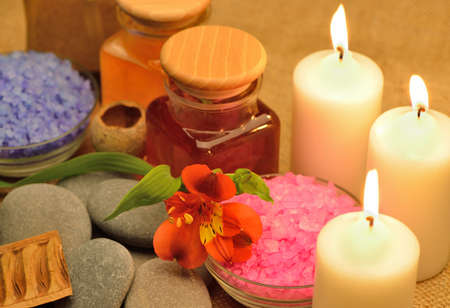 Object for the spa. Candles burning, pebble, a Lily, a bottle with oil, liquid soap, and more. Stock Photo - 13874755