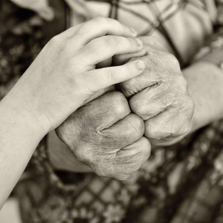 Old and young hands photo