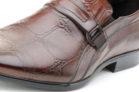 mens shoes: Mans shoes. A red skin. A photo closeup.