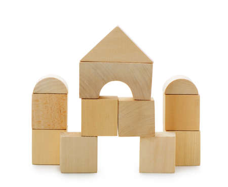 tower block: The house from toy wooden cubes. It is isolated on a white background Stock Photo