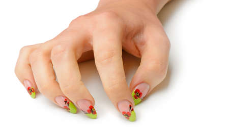 Female hand with manicure closeup. Isolated on white.Drawing red poppy flowers. Stock Photo - 13979090