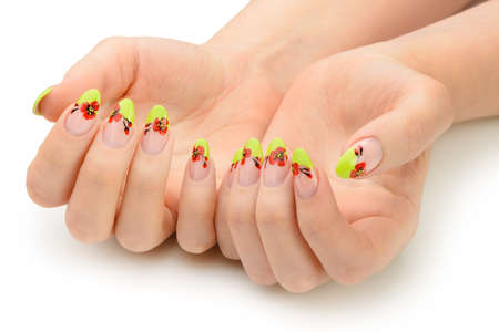 Female hands with manicure closeup. Isolated on white. Drawing red poppy flowers. Stock Photo - 13979168