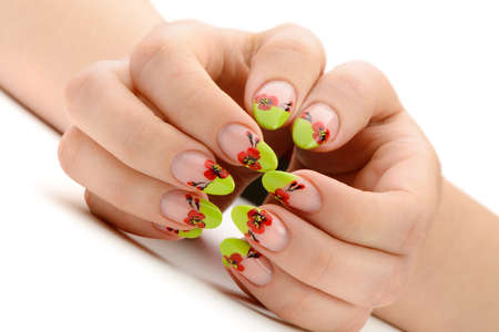Female hands with manicure closeup. Isolated on white. Drawing red poppy flowers. photo
