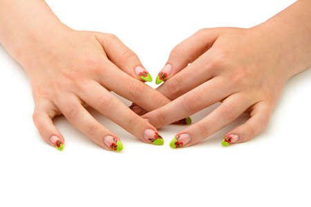 Female hands with manicure closeup. Isolated on white. Drawing red poppy flowers. Stock Photo - 13979164