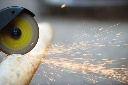 grinder: Cutting metal  angle grinder, sparks from the disk