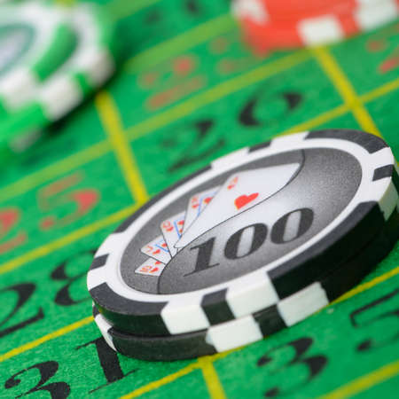 Gaming chips on the green cloth casino. High detailed photo photo