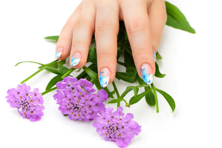 human fingernail: Nail art. Female nails with figure of petal blue color closeup and flower