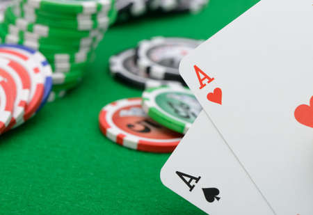 Gaming chips and cards on the green cloth. A winning combination in Black Jack photo