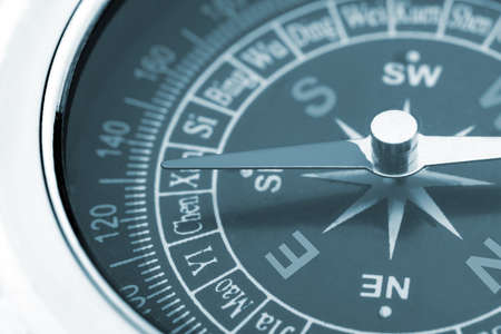 compass closeup blue toned. Instrument that indicates magnetic north Stock Photo - 14660404