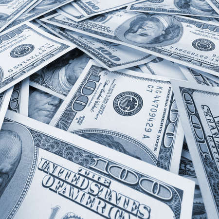 blue toned: A lot of dollars.Highly detailed picture of American money. Blue toned Stock Photo